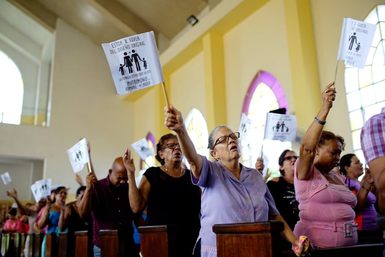 Image: Worshippers wave paper flags during a service at a Methodist Church in Havana