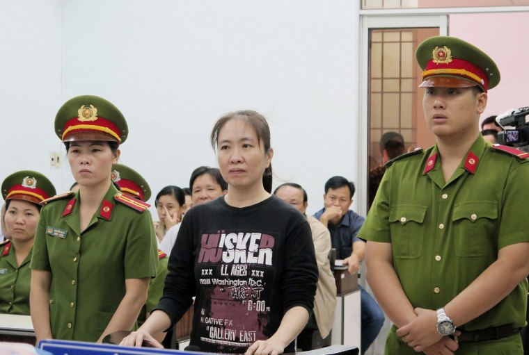 Image: Nguyen Ngoc Nhu Quynh, center, a prominent Vietnamese blogger, stands trial in the south-central province of Khanh Hoa, Vietnam on Nov. 30, 2017.
