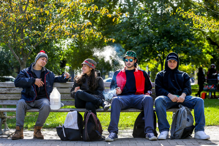 Image: People smoke on the day Canada legalizes recreational marijuana at Trinity Bellwoods Park.