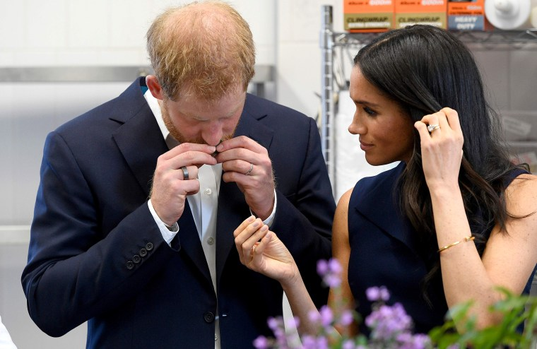 Image: Britain's Prince Harry and and his wife Meghan, Duchess of Sussex sample ingredients used in native food at the Charcoal Lane Mission Australia social enterprise restaurant in Melbourne on Oct. 18, 2018.