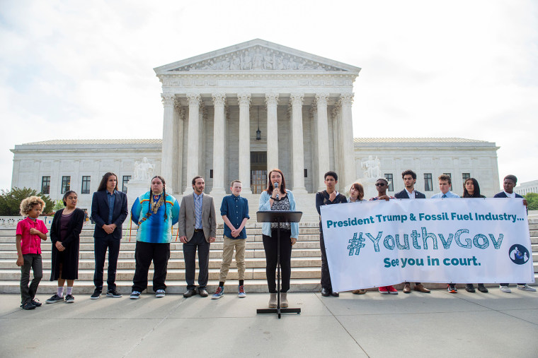 Youth plaintiffs speak during a press conference on the sidewalk in front of the United States Supreme Court in Washington. The youth are part of 21 plaintiffs in a landmark federal lawsuit which accuses the federal government of violating their constitut
