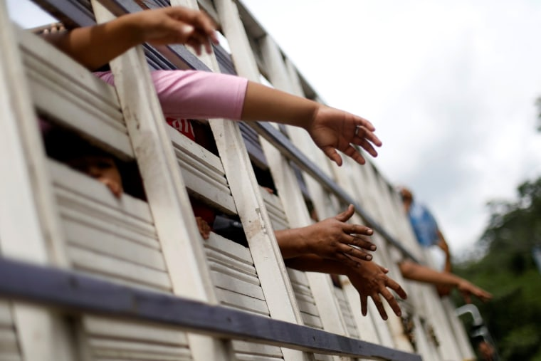Honduran migrants, part of a caravan trying to reach the U.S., are pictured inside a truck  in Quezaltepeque