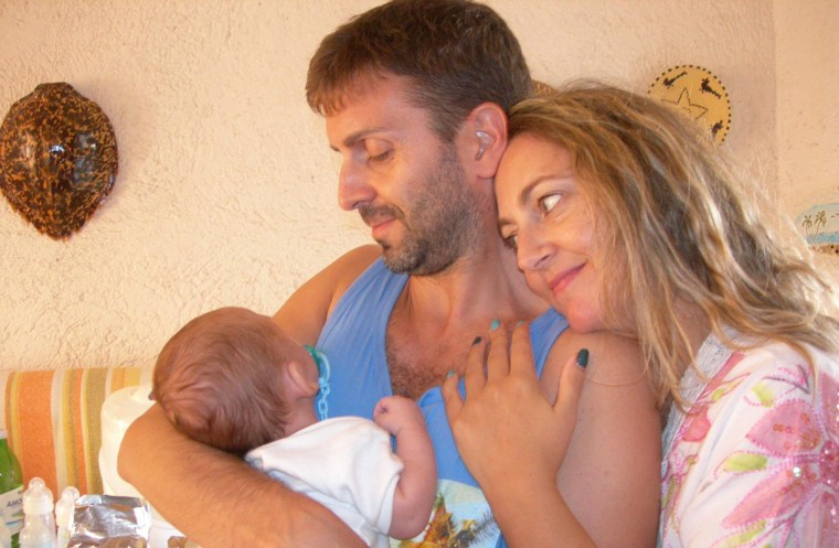 Image: Silvia Rosetti, Gianluca Ottavi, and their baby, Nathan