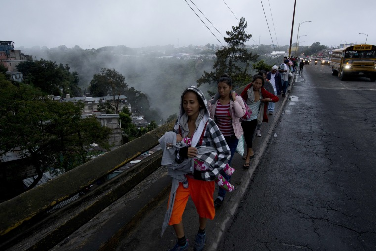 Honduran migrants leave Guatemala City at sunrise Thursday, Oct. 18, 2018 as they make continue their way north toward the U.S.