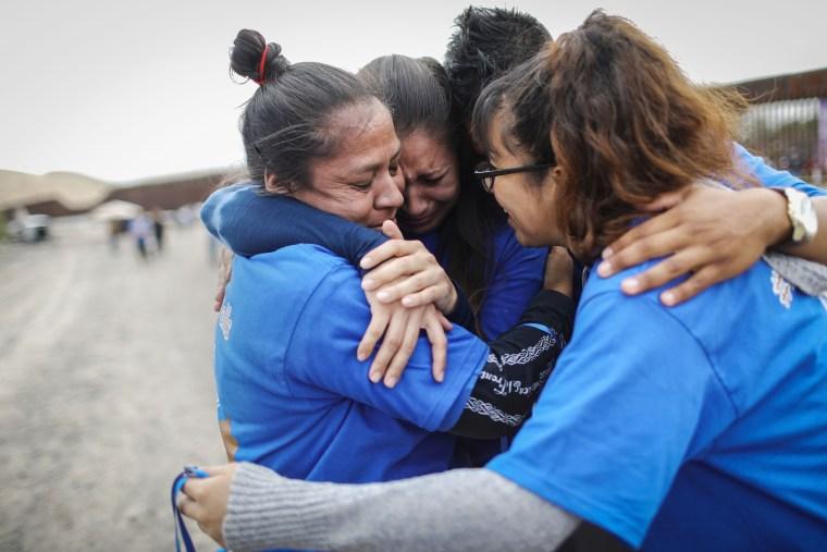 Image: Hugs Not Walls Event Briefly Reunites Families At US-Mexico Border Wall