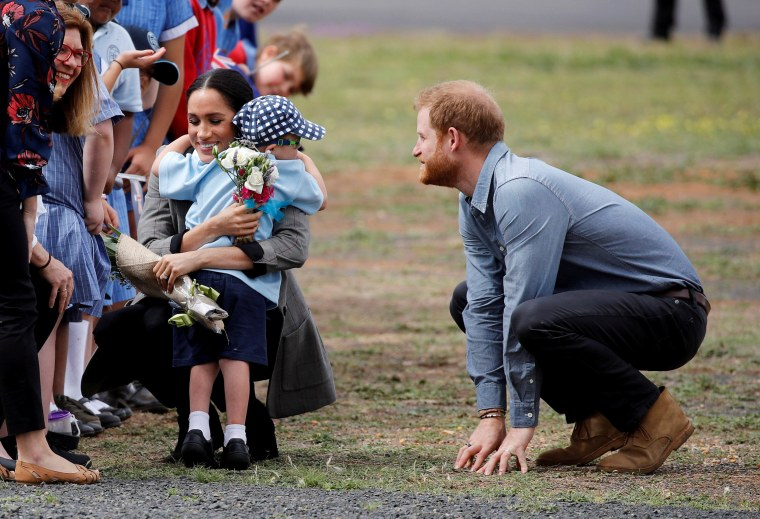 Image: Britain's Prince Harry and Meghan, Duchess of Sussex, interact with Luke Vincent, 5, after arriving at Dubbo airport, Dubbo