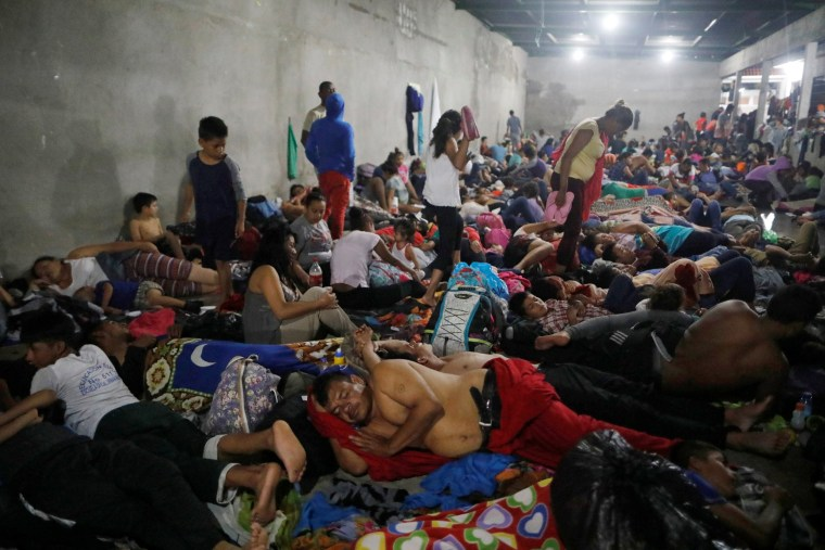 Image: Honduran migrants, part of a caravan trying to reach the U.S., rest inside a shelter during a new leg of their travel in Tecun Uman