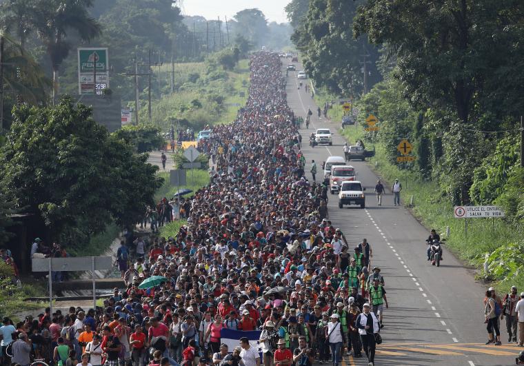 A migrant caravan walks into the interior of Mexico after crossing the Guatemalan border on Oct. 21, 2018 near Ciudad Hidalgo, Mexico.