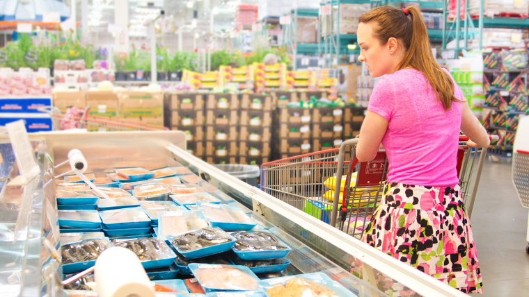 Woman Shopping for Fresh Fish Seafood in Supermarket Retail Store