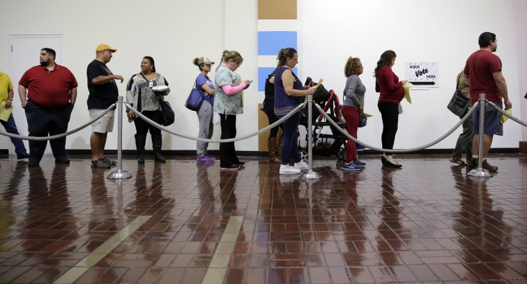 Image: Voters wait in line to cast ballots at an early polling site in San Antonio