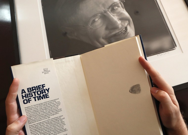 Image: A book signed with a thumb print by Stephen Hawking is one of the personal and academic possessions of Stephen Hawking at Christies auction house