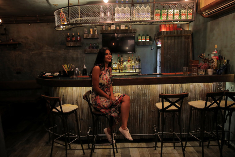 Image: Rasha, 30, the owner of Esco Bar, poses for a photograph in the Old City of Damascus, Syria