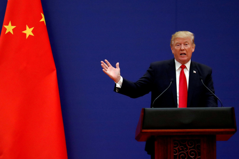 Image: U.S. President Donald Trump delivers his speech as he and China's President Xi Jinping meet business leaders at the Great Hall of the People in Beijing