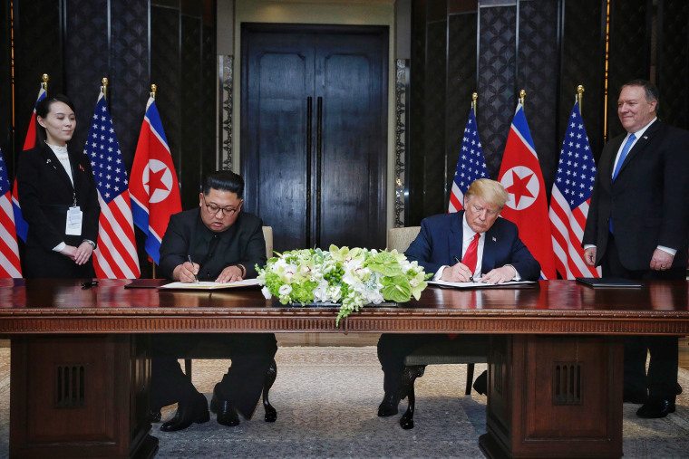 Image: President Donald Trump and Kim Jong-un at their historic Singapore summit in June