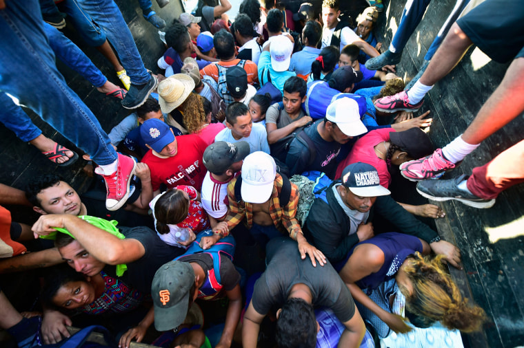Migrants board a truck in Metapa on their way to Tapachula, Mexico, on Monday.