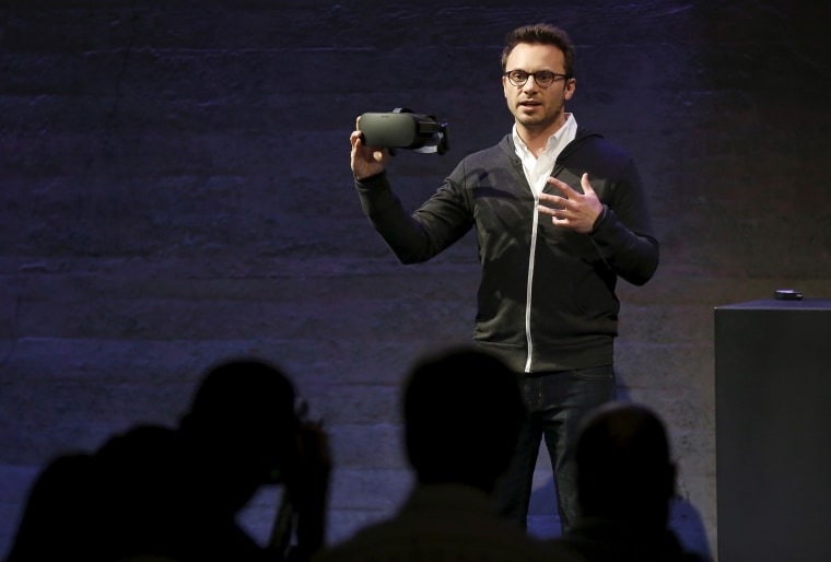 Oculus CEO Brendan Iribe displays a virtual reality headset during an event in San Francisco