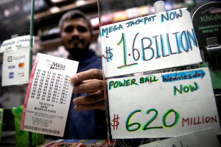 Image: A newsstand vendor displays tickets for Tuesday's Mega Millions lottery drawing in New York City