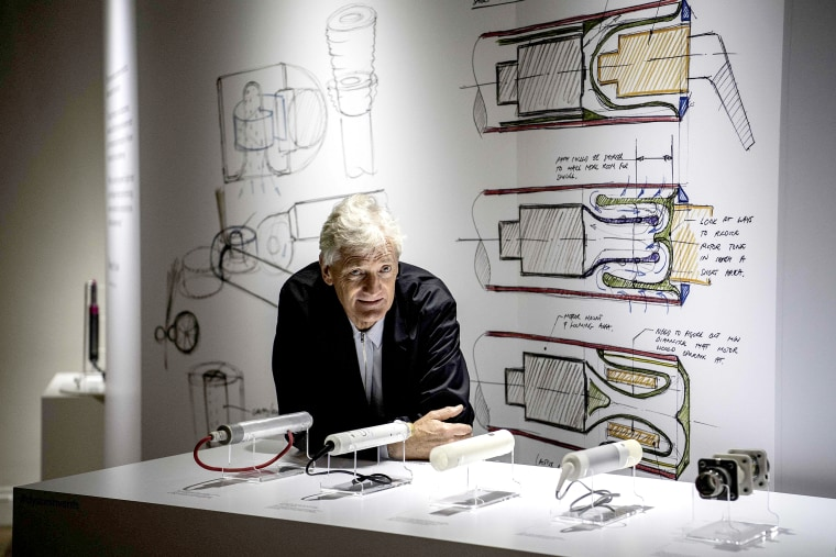 Image: British industrial design engineer and founder of the Dyson company, James Dyson, poses with products at a hotel in Paris on Oct. 11, 2018.