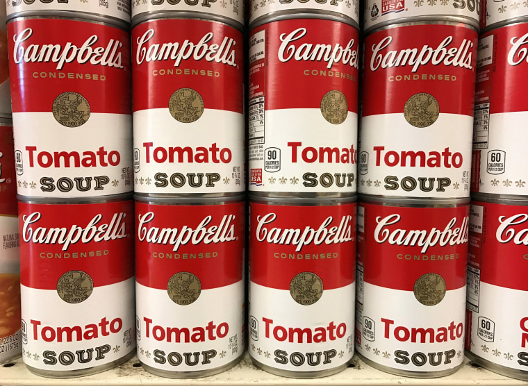 Image: Tins of Campbell's Tomato Soup are seen on a supermarket shelf in Seattle