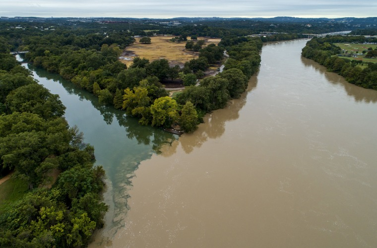 Barton Creek meets the dirty waters of the rain-swollen Lady Bird Lake in Austin, Texas, on Tuesday. Recent floods have caused a citywide boil-water notice that could last 10-14 days.