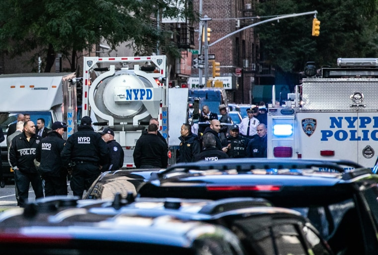 Image: Police investigators gather around a bomb squad truck outside the Time Warner Center in New York after the discovery of an explosive device at the CNN offices on Wednesday, Oct. 24, 2018.