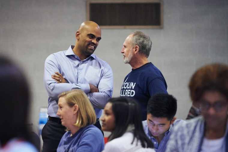 Congressional candidate Colin Allred speaks with an attendee at a fish fry hosted by the Dallas County Democratic Party in Dallas on Oct. 19, 2018.