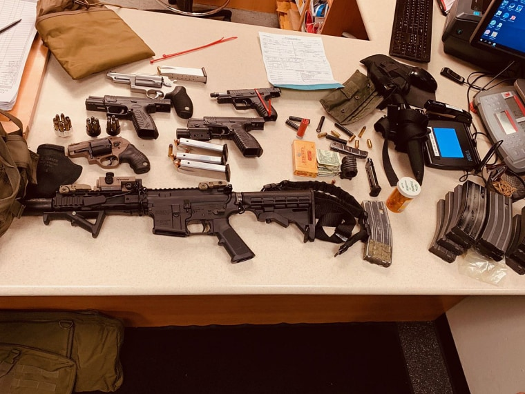 An arsenal of weapons and a bullet-resistant vest were seized after David Goldammer was found sleeping in his car in Miami Beach.