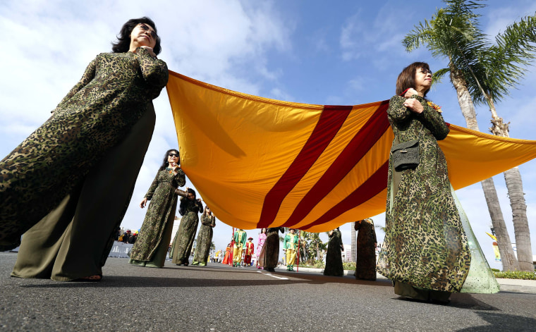 Participants carry the former South Vietnam flag during the Tet parade in the Little Saigon area of Westminster, California on Feb. 4, 2017.