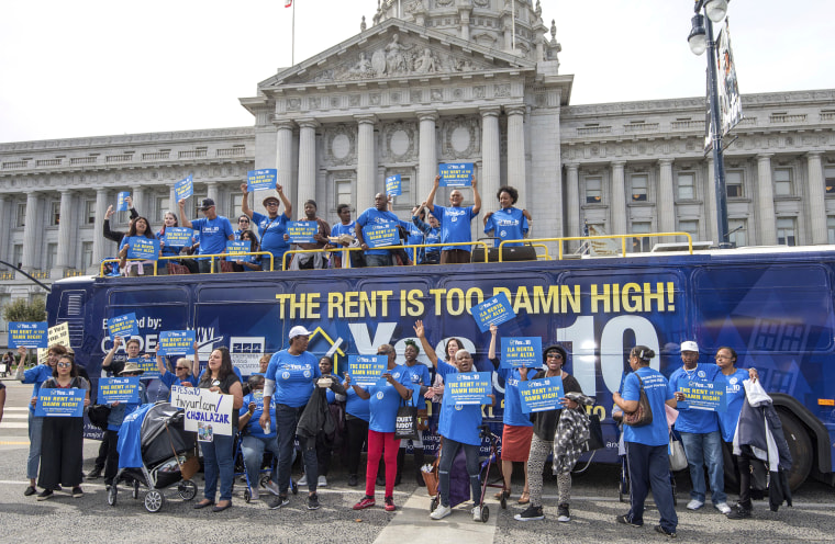 "Image: Supporters demonstrate as the Yes on 10 ""Rent Is Too Damn High"" statewide bus tour arrives at City Hall ahead of the San Francisco Board of Supervisors endorsement of Proposition 10 on Oct. 2, 2018 in San Francisco."