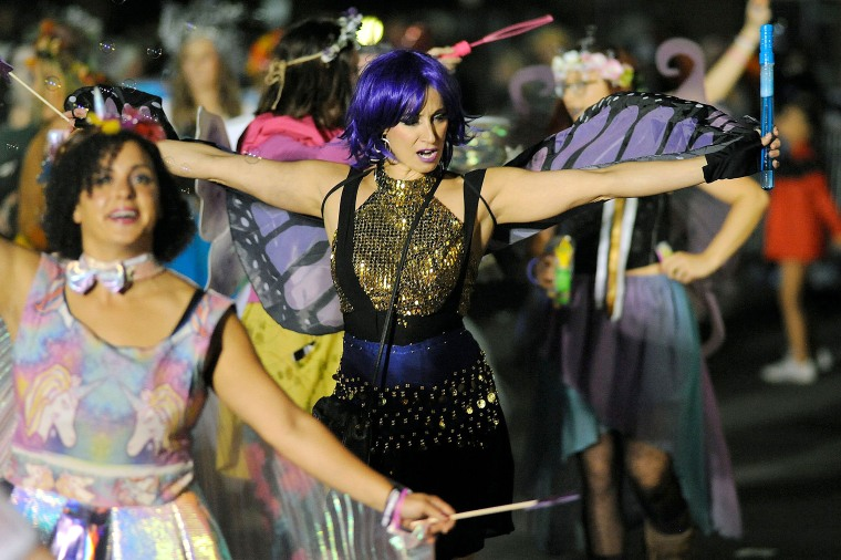 Image: Witches and fairies made their way down the parade route during the 23rd Annual Salem Chamber of Commerce Haunted Happenings Grand Parade
