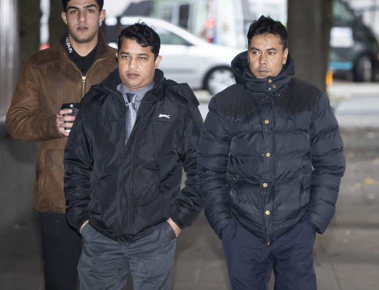 Harun Rashid, left, 38, and Mohammed Kuddus, right, 40, arrive at Manchester Crown Court