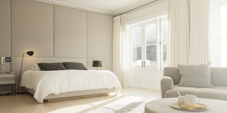 Sunny Bedroom With Sitting Area