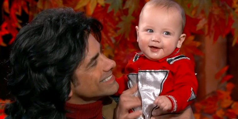John Stamos shows off his son Billy, dressed as Mork, at the Jimmy Kimmel Show.