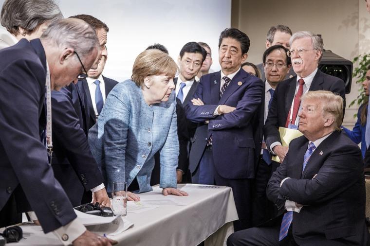 German Chancellor Angela Merkel speaks with U.S. President Donald Trump during the G-7 summit