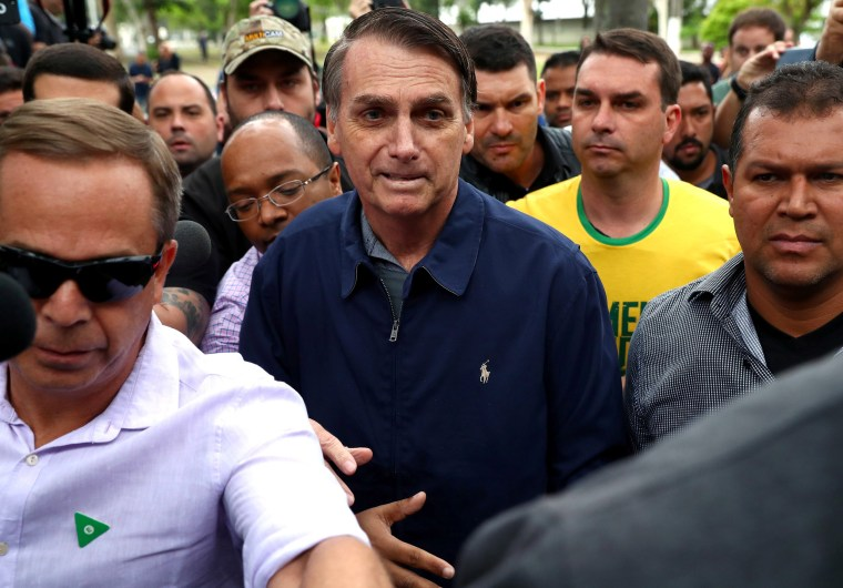 Image: Jair Bolsonaro, far-right lawmaker and presidential candidate of the Social Liberal Party (PSL), arrives to cast his vote in Rio de Janeiro