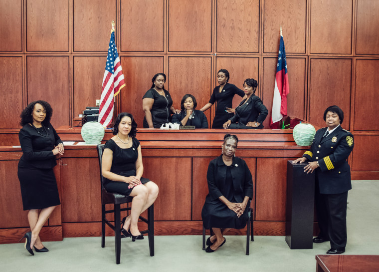 Tiffany Carter Sellers, center, chief judge; LaDawn Blackett Jones, left, the city's prosecutor; and Viveca Powell, public defender, front row, third from left, are among the black women in charge of the criminal justice system in South Fulton, Georgia.
