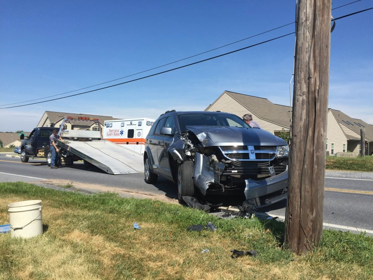 Tow Truck Operators Prepare To Remove An Suv That Struck A Utility Pole In North Lebanon Township Pennsylvania John Latimer Daily News Via Ap
