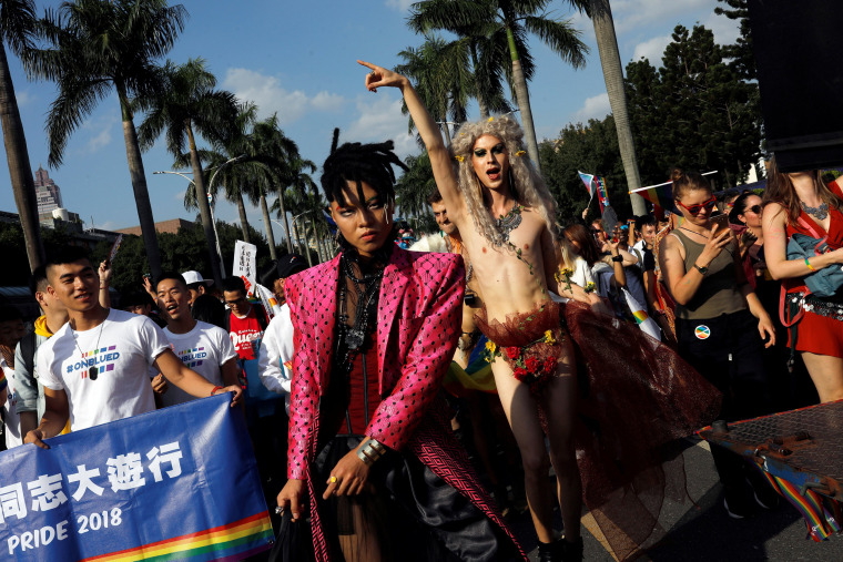 Image: Participants take part in a LGBT pride parade to support same-sex marriage in Taipei