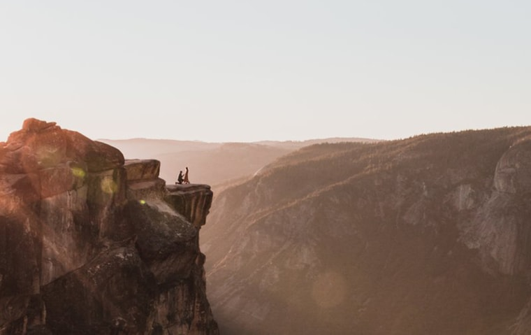 Proposal moment captured from a distance in Yosemite Park