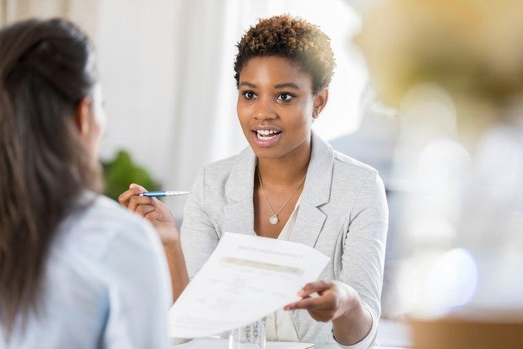 Businesswomen meet to discuss document