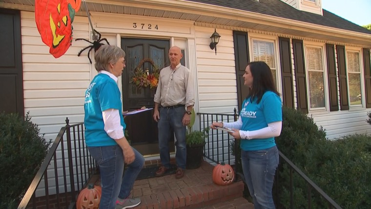 Democratic activists go door-to-door in a suburb of Charlotte, North Carolina.