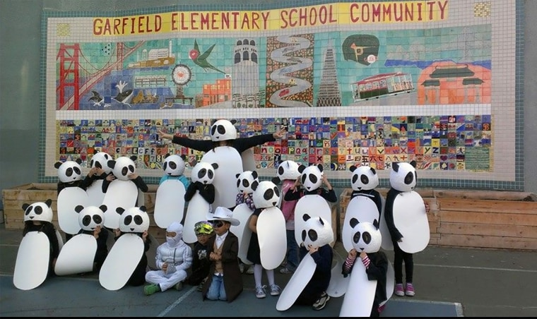 Image: Monica Lun and her students in panda costumes