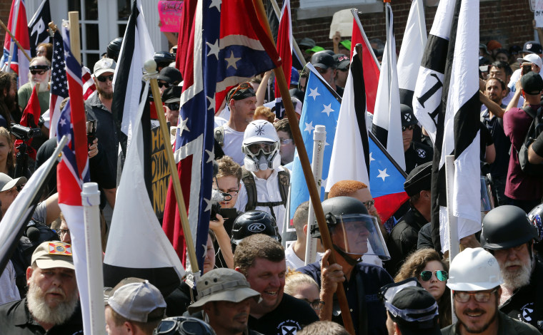 White nationalist demonstrators walk into the entrance of Lee Park in Charlottesville, Virginia, on Aug. 12, 2017.
