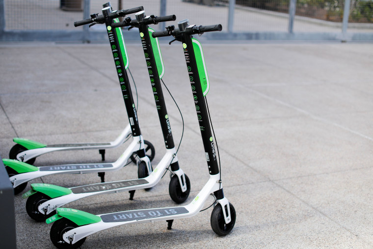 Image: Smart phone app time-of-use electric scooters from Lime-S are shown parked along a sidewalk in San Diego, California