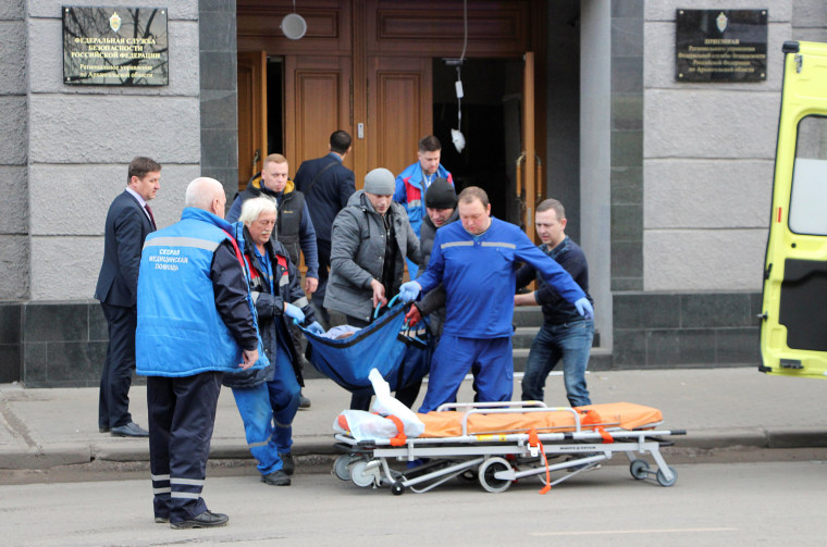 Image: Medics work at the site of an explosion at an office of Russia's Federal Security Service in Arkhangelsk