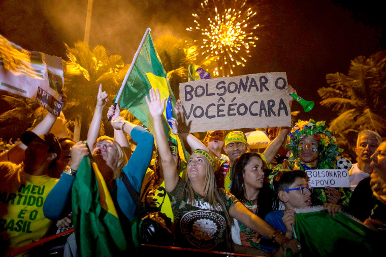 Image: Supporters of far-right presidential candidate Jair Bolsonaro, celebrate in front of his house in Rio de Janeiro, Brazil, after he won Brazil's presidential election, on Oct. 28, 2018.