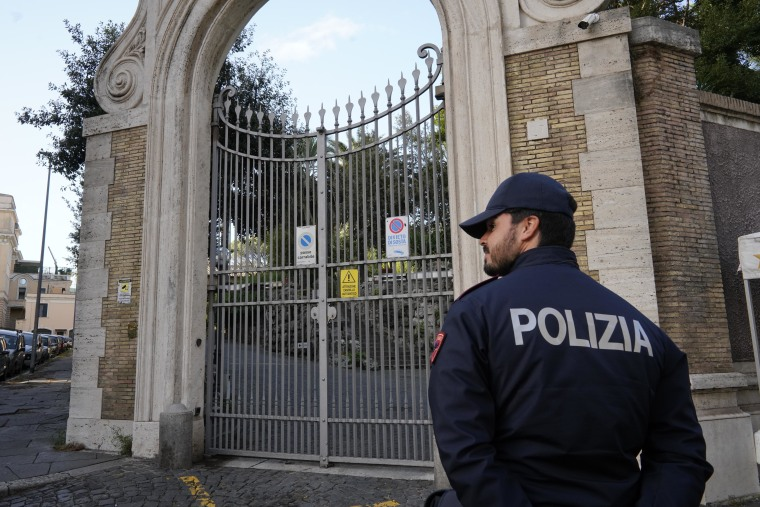 Image: Police guard the Apostolic Nunciature, the Vatican's embassy to Italy