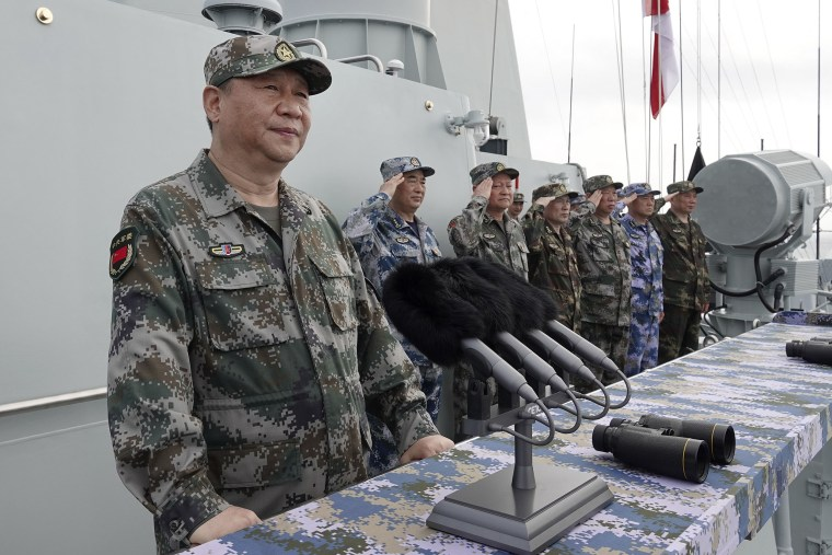 Image: Chinese President Xi Jinping speaks after reviewing the Chinese People's Liberation Army (PLA) Navy fleet in the South China Sea