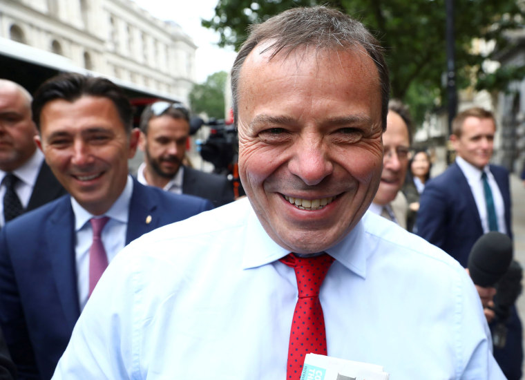 Image: Arron Banks and Andy Wigmore, who ran the Leave.Eu pro-Brexit referendum campaign, arrive to give evidence to the Digital Culture Media and Sport Parliamentary Committee in London