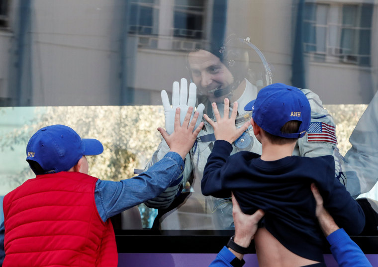 Image: International Space Station (ISS) crew member and astronaut Nick Hague of the U.S. gestures to his children as he leaves to board the spacecraft at the Baikonur Cosmodrome